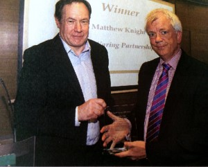 Matthew Knight being presented with the  outstanding qualified practitioner student of the year award at the STEP Excellence Awards  2014 ceremony